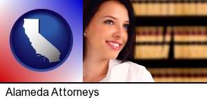 Alameda, California - a young, female attorney in a law library