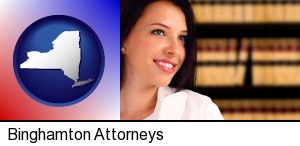Binghamton, New York - a young, female attorney in a law library