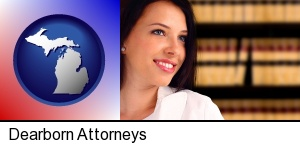 Dearborn, Michigan - a young, female attorney in a law library