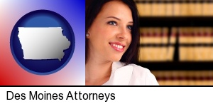 Des Moines, Iowa - a young, female attorney in a law library