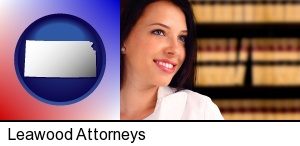 Leawood, Kansas - a young, female attorney in a law library
