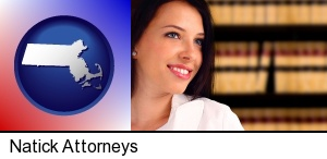Natick, Massachusetts - a young, female attorney in a law library