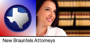 New Braunfels, Texas - a young, female attorney in a law library