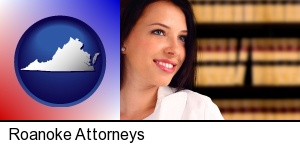 Roanoke, Virginia - a young, female attorney in a law library