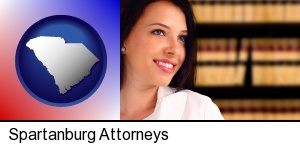 Spartanburg, South Carolina - a young, female attorney in a law library