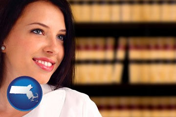 a young, female attorney in a law library - with Massachusetts icon