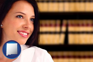 a young, female attorney in a law library - with New Mexico icon