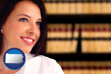 a young, female attorney in a law library - with Pennsylvania icon