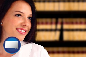 a young, female attorney in a law library - with South Dakota icon