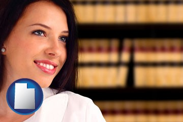 a young, female attorney in a law library - with Utah icon