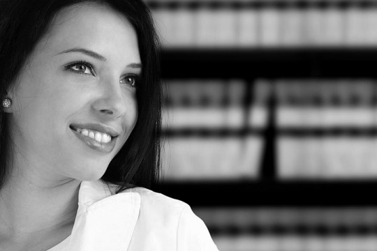 a young, female attorney in a law library