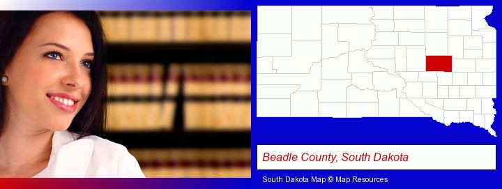 a young, female attorney in a law library; Beadle County, South Dakota highlighted in red on a map