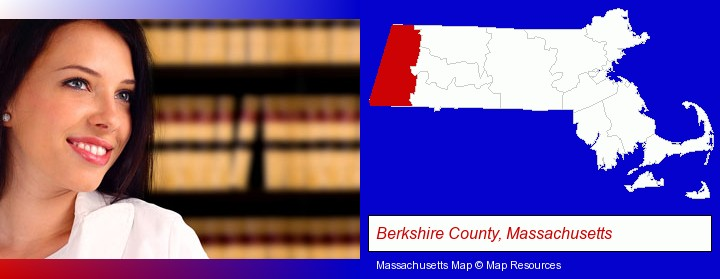 a young, female attorney in a law library; Berkshire County, Massachusetts highlighted in red on a map