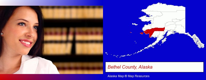 a young, female attorney in a law library; Bethel County, Alaska highlighted in red on a map
