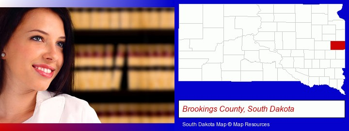 a young, female attorney in a law library; Brookings County, South Dakota highlighted in red on a map