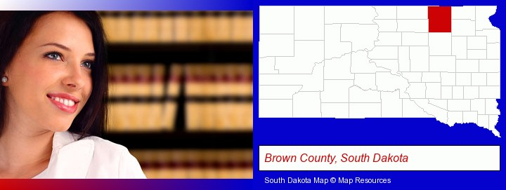 a young, female attorney in a law library; Brown County, South Dakota highlighted in red on a map