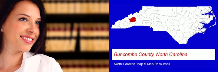 a young, female attorney in a law library; Buncombe County, North Carolina highlighted in red on a map