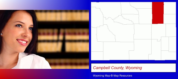 a young, female attorney in a law library; Campbell County, Wyoming highlighted in red on a map