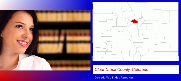 a young, female attorney in a law library; Clear Creek County, Colorado highlighted in red on a map