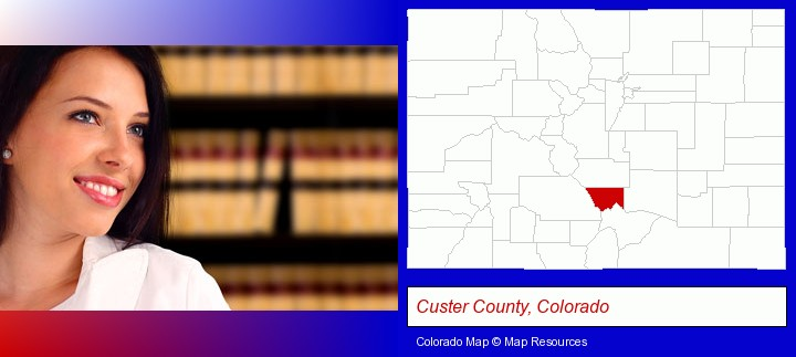 a young, female attorney in a law library; Custer County, Colorado highlighted in red on a map