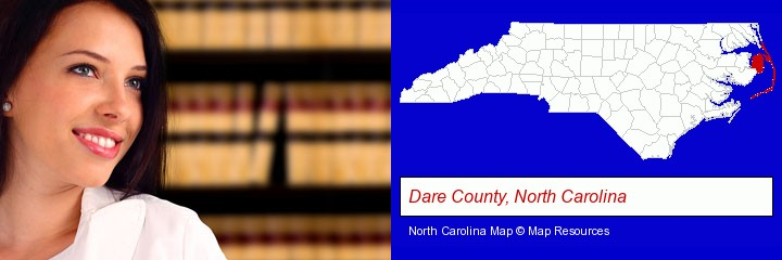 a young, female attorney in a law library; Dare County, North Carolina highlighted in red on a map