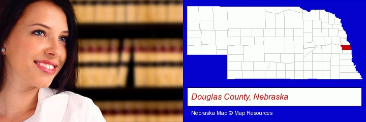 a young, female attorney in a law library; Douglas County, Nebraska highlighted in red on a map