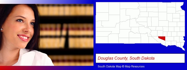 a young, female attorney in a law library; Douglas County, South Dakota highlighted in red on a map