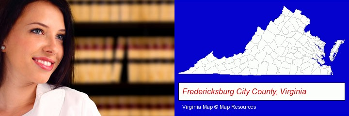 a young, female attorney in a law library; Fredericksburg City County, Virginia highlighted in red on a map