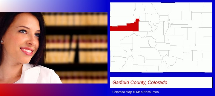 a young, female attorney in a law library; Garfield County, Colorado highlighted in red on a map