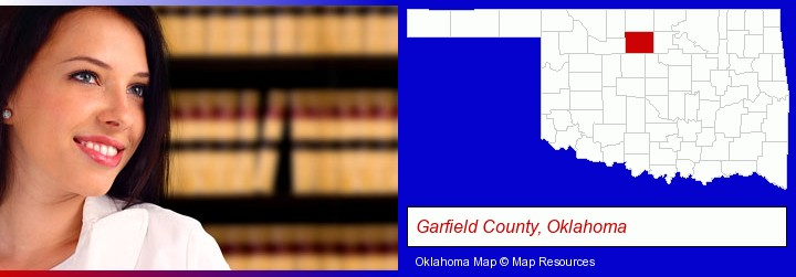 a young, female attorney in a law library; Garfield County, Oklahoma highlighted in red on a map