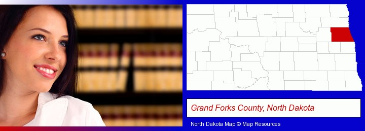 a young, female attorney in a law library; Grand Forks County, North Dakota highlighted in red on a map