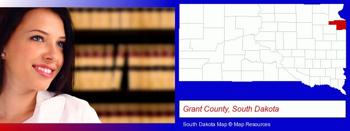 a young, female attorney in a law library; Grant County, South Dakota highlighted in red on a map