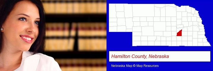 a young, female attorney in a law library; Hamilton County, Nebraska highlighted in red on a map