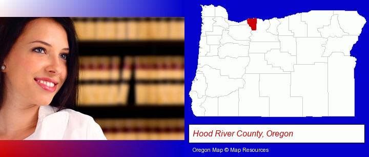 a young, female attorney in a law library; Hood River County, Oregon highlighted in red on a map