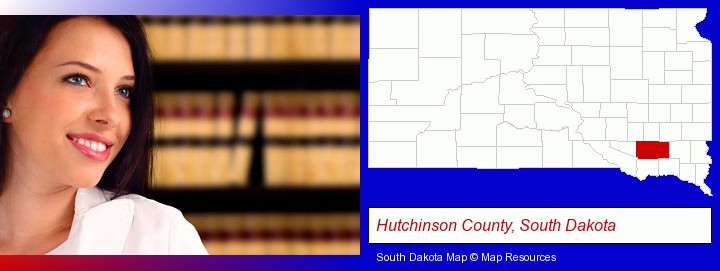 a young, female attorney in a law library; Hutchinson County, South Dakota highlighted in red on a map