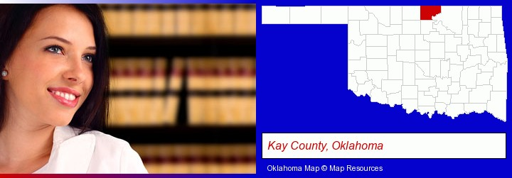 a young, female attorney in a law library; Kay County, Oklahoma highlighted in red on a map
