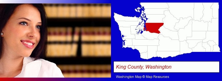a young, female attorney in a law library; King County, Washington highlighted in red on a map