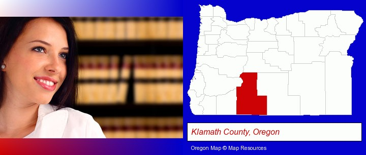 a young, female attorney in a law library; Klamath County, Oregon highlighted in red on a map