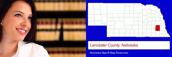 a young, female attorney in a law library; Lancaster County, Nebraska highlighted in red on a map