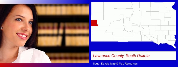 a young, female attorney in a law library; Lawrence County, South Dakota highlighted in red on a map