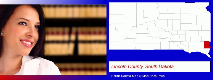 a young, female attorney in a law library; Lincoln County, South Dakota highlighted in red on a map