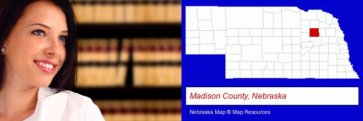 a young, female attorney in a law library; Madison County, Nebraska highlighted in red on a map