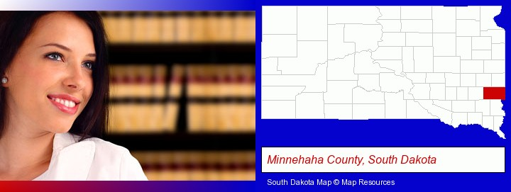 a young, female attorney in a law library; Minnehaha County, South Dakota highlighted in red on a map