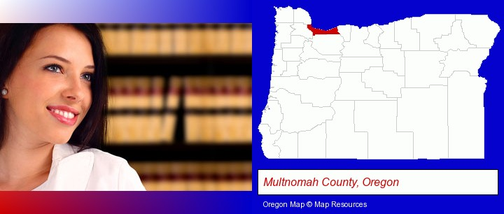 a young, female attorney in a law library; Multnomah County, Oregon highlighted in red on a map