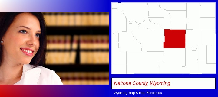 a young, female attorney in a law library; Natrona County, Wyoming highlighted in red on a map