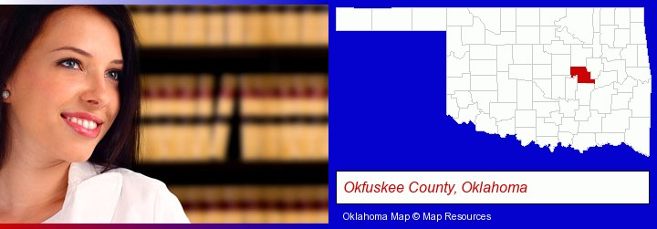 a young, female attorney in a law library; Okfuskee County, Oklahoma highlighted in red on a map