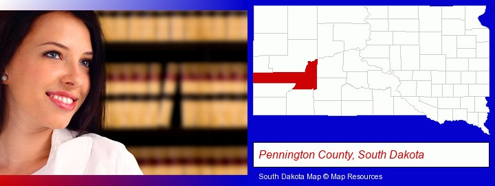 a young, female attorney in a law library; Pennington County, South Dakota highlighted in red on a map