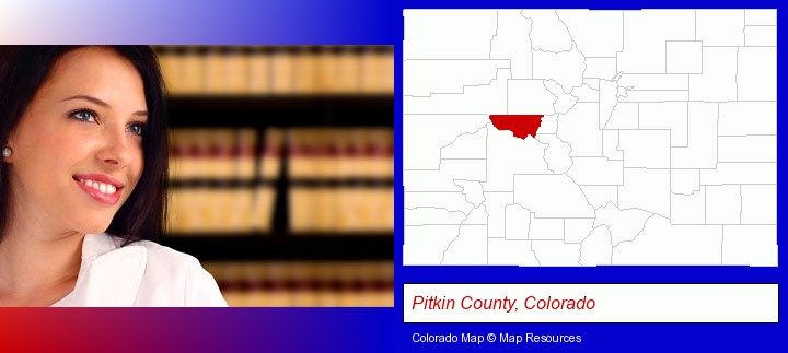 a young, female attorney in a law library; Pitkin County, Colorado highlighted in red on a map