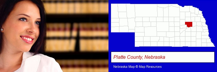 a young, female attorney in a law library; Platte County, Nebraska highlighted in red on a map