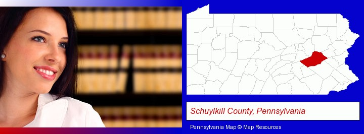 a young, female attorney in a law library; Schuylkill County, Pennsylvania highlighted in red on a map